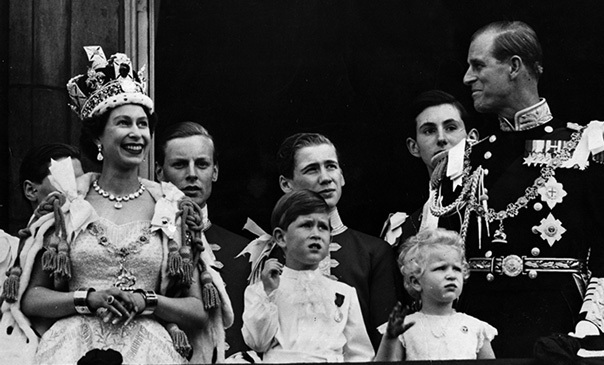 Queen Elizabeth II is seen on the balcony of Buckingham Palace after her Coronation ceremony in 1952 with (left to right); Prince Charles, Princess Anne and her beloved husband, Prince Philip, watching on.