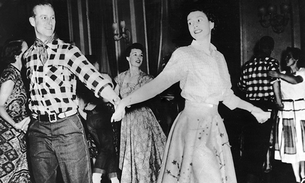 The Duke of Edinburgh cuts a rug with his wife at a square dance held in their honor in Ottawa, Canada on Oct. 17, 1951.
