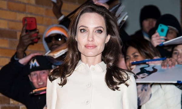"Angelina strikes a pose following her Dec. 4 appearance on ""The Daily Show"" in New York City."