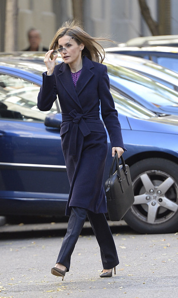 On her way to a meeting in December 2014, Letizia stuck with the navy hue with her long BOSS coat and slacks.