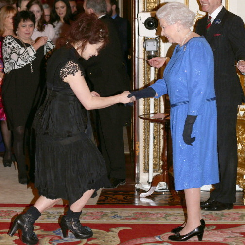 "HBC meets HRH: <a href=""http://us.hellomagazine.com/tags/1/helena-bonham-carter/""><strong>Helena Bonham Carter</strong></a> broke out into a wide grin while greeting the Queen at the Dramatic Arts event in 2014.