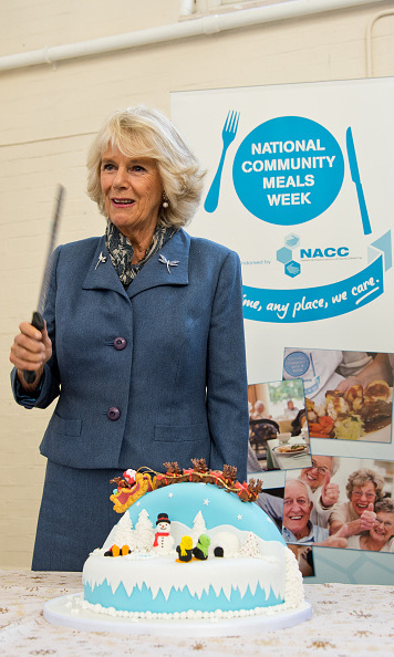 Camilla personally cut the cake she bought for volunteers at a December 2014 charity event in England.