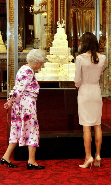 The Queen and Kate Middleton inspected the 2011 Royal Wedding cake on display at Buckingham Palace's annual summer opening a couple of months after Kate walked down the aisle in April of that year.