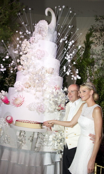 Princess Charlene of Monaco and Prince Albert II of Monaco posed with their giant wedding cake on July 2, 2011.