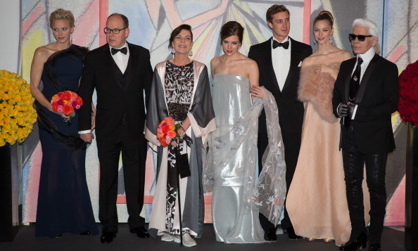 Uncle Karl! The Monaco royals (from left to right: Princess Charlene of Monaco, Prince Albert II of Monaco, Princess Caroline of Hanover, Caroline's daughter Charlotte Casiraghi, son Pierre Casiraghi, Pierre's fiance Beatrice Borromeo) posed with Chanel designer Karl Lagerfeld during the Rose Ball at Sporting Monte-Carlo in March 2014.