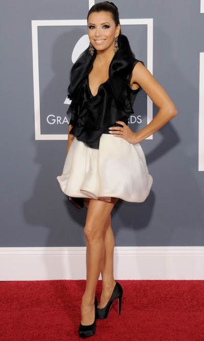 Eva Longoria turned heads on the red carpet in 2011 when she wore a monochrome Ashi dress accessorized with a Sergio Rossi clutch and Brian Atwood shoes.