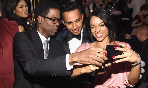 Chris Rock, Lewis Hamilton and Rosario Dawson