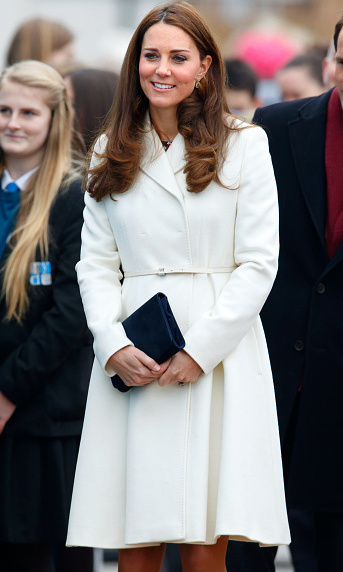 With just a few months left in her pregnancy, Kate looked lovely in a white Max Mara coat, navy L.K. Bennett clutch and Jimmy Choo pumps while visiting the 1851 Trust for sailing in Portsmouth on February 12. 