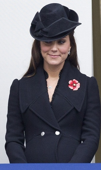 Kate looked stylish even when she bundled up in a black Alexander McQueen coat with a matching hat by Jane Corbett at a Remembrance Sunday ceremony on November 9. 