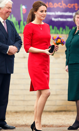 The mom-to-be looked regal in red as she stepped out on November 25 to attend a charity event in Norwich, England. 