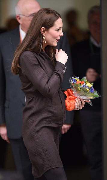 The Duchess of Cambridge showed off her baby bump in a chocolate shirtdress by Hobbs at an event hosted by The Fostering Network on January 16. 
