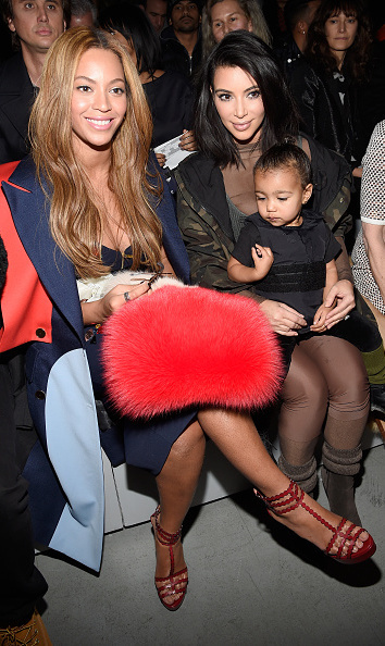 North eyed Beyonce's bag during her dad's adidas Originals x Kanye West YEEZY SEASON 1 fashion show on February 12.