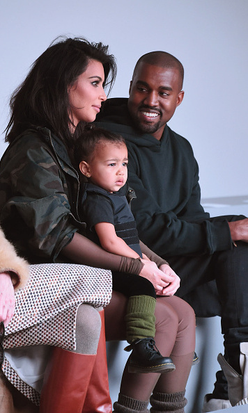 North sat front row with her parents during Mercedes-Benz Fashion Week Fall 2015 on February 12 in New York City. 