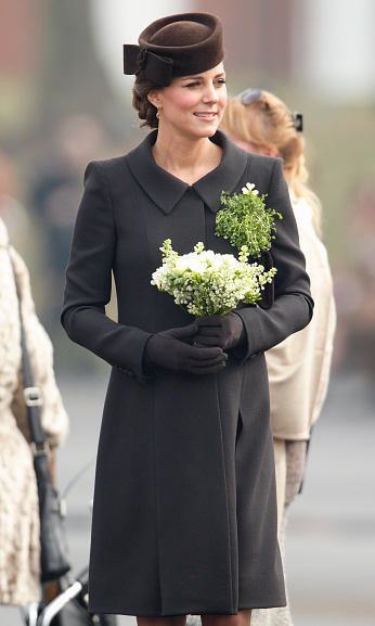 Shunning the tradition of wearing green Kate for a brown Catherine Walker coat at the annual St Patrick's Day Parade at Mons Barracks on March 17.