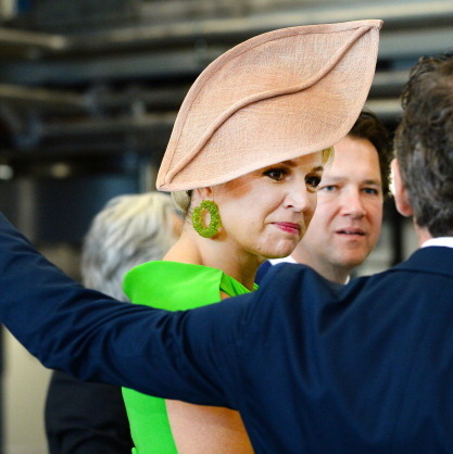 Her highness debuted an oversized leaf-shaped taupe fascinator during the opening of a new building of Unipro.