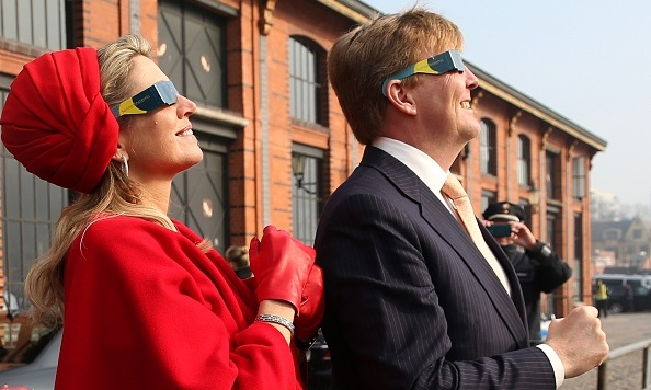 Máxima's look was out of this world as she watched a partial solar eclipse in a fantastic red turban and protective spectacles in Hamburg, Germany.