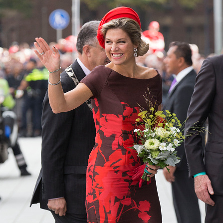 Making a bold statement in red royal casque as she attended the opening of the new Markthal in Rotterdam, Netherlands.