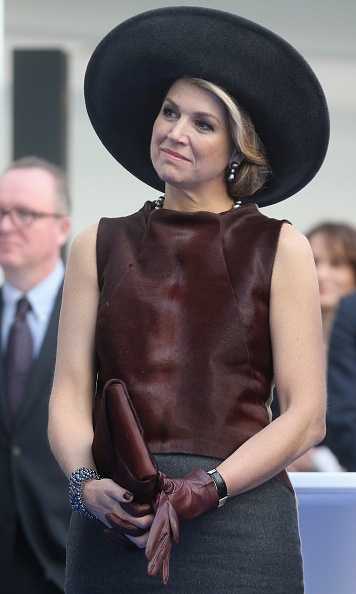 Ever a fan of the wide brim, she donned a black millinery during a state visit to Germany.