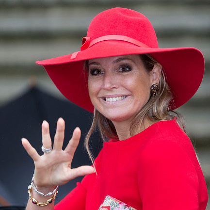 Attending the Symposium of 40 years protection from domestic violence, the Queen wore a bright red flouncy fedora with ribbon trim.