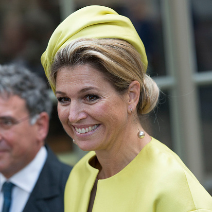 Attending the opening of the new Micropia Museum she proved her preference for yellow in a silk gathered toque hat.