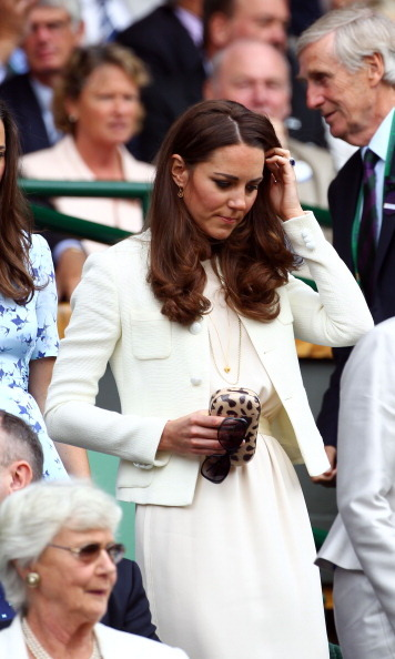 In 2013, the Duchess of Cambridge donned a Joseph dress and tweed jacket, both previously worn on separate occasions. She combined the ensemble with a leopard Diane von Furstenberg box clutch and cool Givenchy shades.