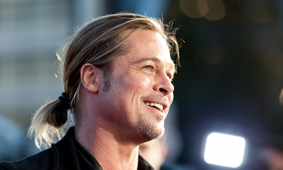 "It all started in 1994, when <a href=""http://us.hellomagazine.com/tags/1/brad-pitt/""><strong>Brad Pitt</strong></a> played a tender-hearted vampire with a sleek, straight 'tail.' Between roles, the superstar has debuted every incarnation of a bun and pony, including this messy number at the <i>World War Z</i> premiere in Australia.