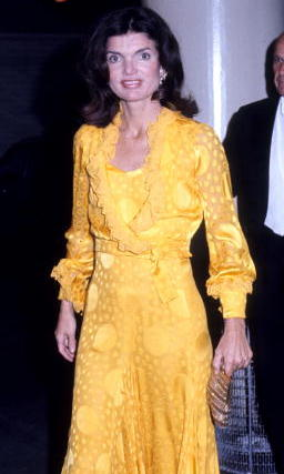 Jackie embraced bold colors and flowing dresses in the 1970s, as seen here at Metropolitan Opera House.