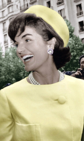 Pastel colors, a pillbox hat and pearls would forever be associated with Mrs. Kennedy.