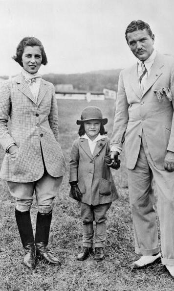Even as a child Jackie showed her knack for fashion, looking adorable in matching riding gear with her parents in the 1930s.