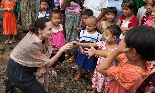July 30: Angelina Jolie Pitt met with children during a visit to Ja Mai Kaung Baptist refugee camp in Myitkyina, Myanmar.