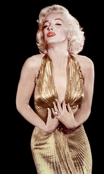 Marilyn was a true golden girl in this metallic halter gown for a portrait session in 1953.