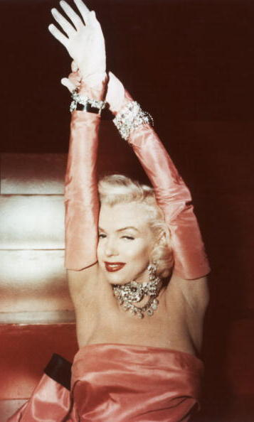 "Creating an image that would be copied by scores of stars that came after her, Marilyn slipped into a hot pink gown for her role in ""Gentlemen Prefer Blondes"", the film that made the song ""Diamonds are a Girl's Best Friend"" a hit.