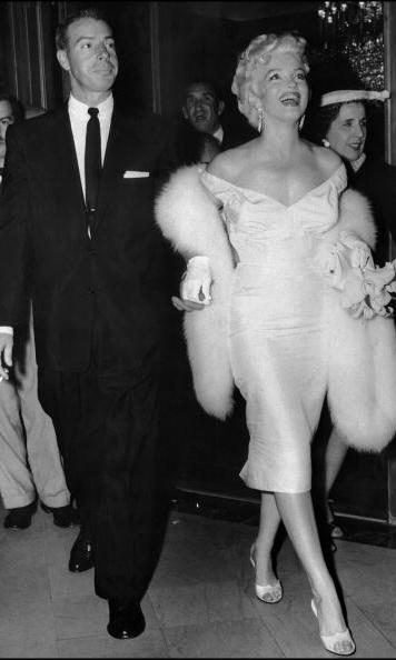 She wasn't so demure when she hit the town with husband Joe in figure-hugging dresses and fur stoles.