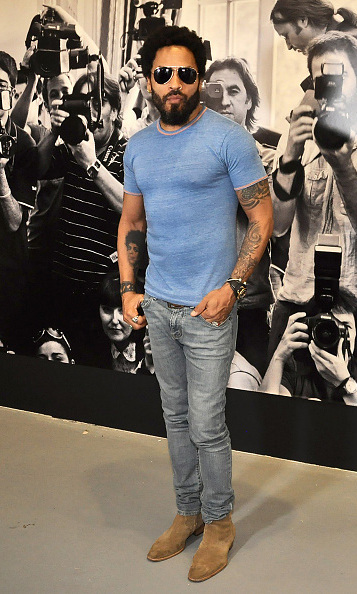 August 10: Lenny Kravitz was cool (and covered!) during his Flash by Lenny Kravitz Exhibition in Vienna. 