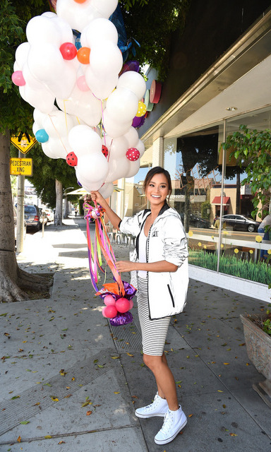 August 12: Jamie Chung picked up balloons in a Victoria's Secret PINK Limited Release Anorak in Beverly Hills. 
