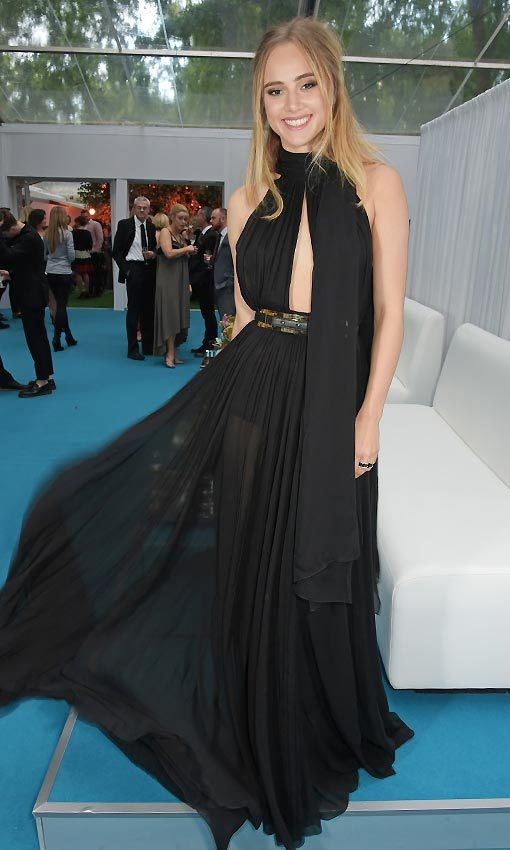 Suki Waterhouse in a sexy transparent Elie Saab design, made from black chiffon that swung with every step. 