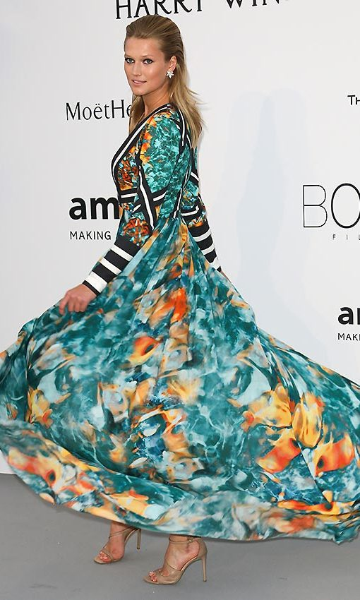 Toni Garrn in an original design that combined a colorful floral print with black and white striped sleeves, courtesy of Elie Saab.