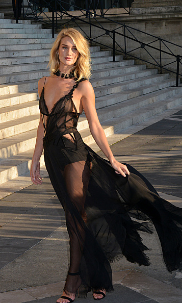 Rosie Huntington-Whiteley at the Versace Haute Couture 2015-2016 show, in a transparent design by the fashion house that flowed in the direction of the breeze. 