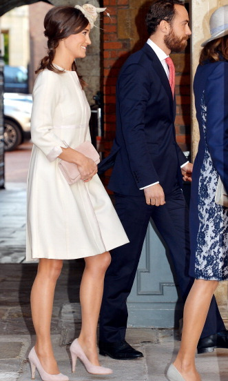 She knows how to accessorize. Pippa chose rose suede shoes and a clutch for Prince George's christening.