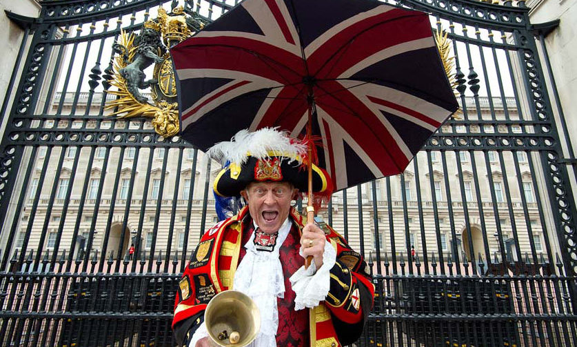 September 9: Royal well-wisher Tony Appleton posed outside Buckingham Palace in a traditional town crier outfit to celebrate the Queen's record reign.