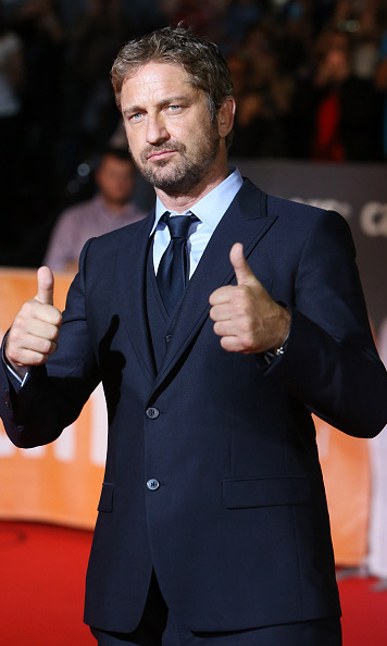 September 15: Gerard Butler gave two thumbs up on the carpet of 'September Shiraz' at the Toronto International Film Festival. 
