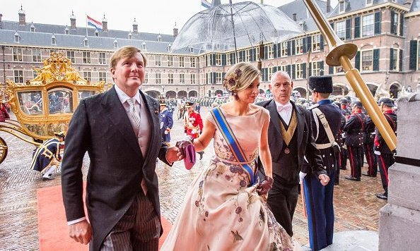 King Willem-Alexander of The Netherlands holds his Queen's hand at the occasion, which marked the opening of the parliamentary year.  <br>