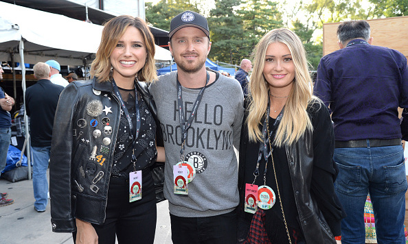 Aaron Paul hung backstage with wife Lauren and Sophia Bush.