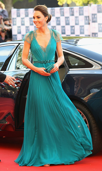 A daring move away from the norm, Kate's teal Jenny Packham gown with an embellished waistband was a bold and beautiful choice for the Olympic concert in May 2012.<br>