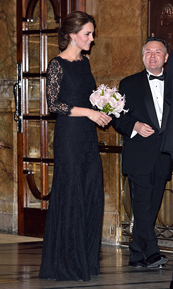 Kate was demure in this black lace Diane Von Furstenberg gown at the Royal Variety Performance in November, just two months after announcing her second pregnancy. Accessorized with a sparkly black clutch and Lola blue topaz hoop earrings by Kiki McDonough, she looked suitably chic for the occasion.<br>