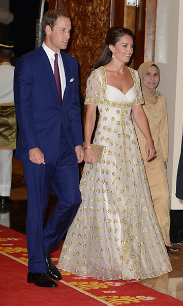 Kate wore an eye-catching white and gold gown from one of her other fave designers, Alexander McQueen, for an official dinner hosted by the King and Queen of Malaysia in September 2012. <br>