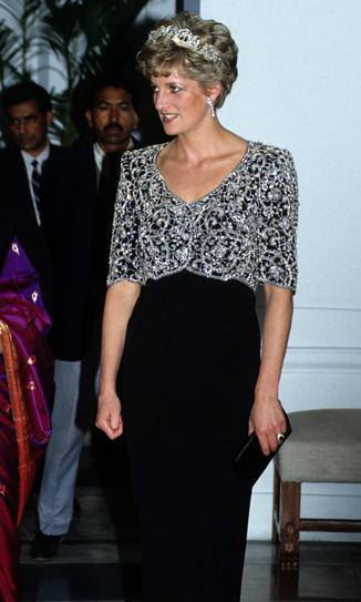 Diana accessorized her Catherine Walker gown with the Spencer family tiara to attend a banquet in India.<br>