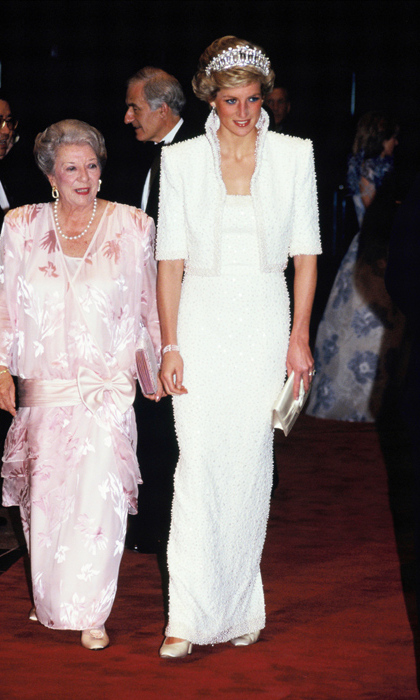 Dubbed the 'Elvis dress' because of the high collar, Diana wore this incredible beaded creation during an official visit to Hong Kong.<br>