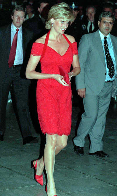 Lady in red! The Princess of Wales wore this gorgeous scarlet Catherine Walker dress to attend a dinner in Buenos Aires. <br>