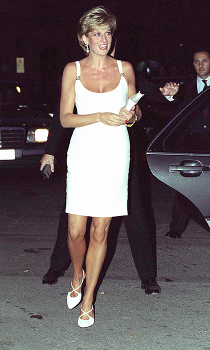Diana looked tanned and confident in a little white dress by close friend Gianni Versace. 